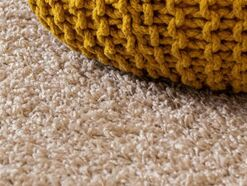 Beige Carpet with ocher knit ottoman- Families Advocating for Chemical & Toxics Safety