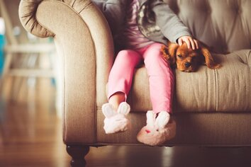 Child on couch with dog- Families Advocating for Chemical & Toxics Safety